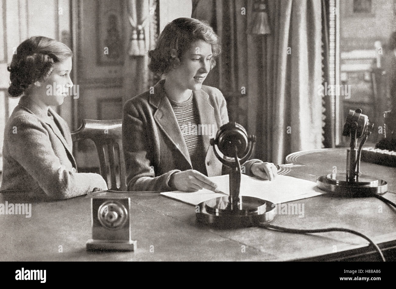 Princess Margaret, left, and Princess Elizabeth, future Queen Elizabeth II, right, broadcasting to the children - Stock Image