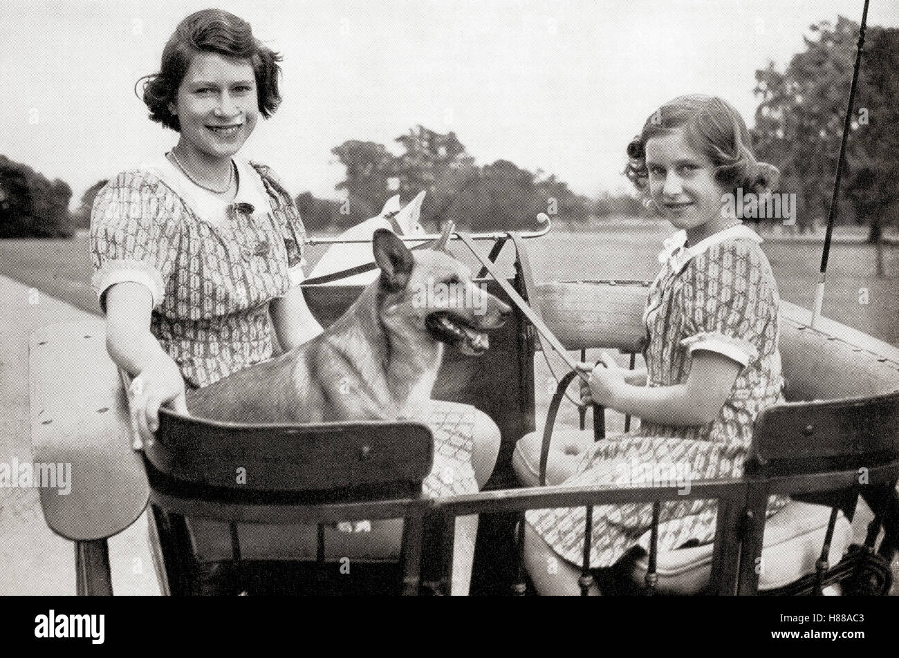 Princess Elizabeth, future Queen Elizabeth II, left, and Princess Margaret, right, driving a pony and trap in Great - Stock Image