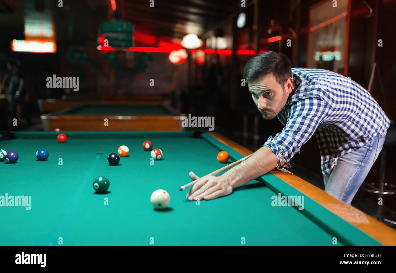 Handsome Man Playing Pool In Pub Stock Photo 125577301