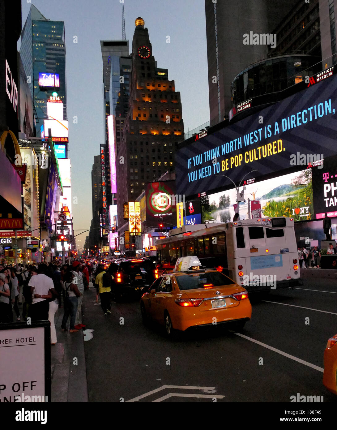 NEW YORK, UNITED STATES. AUGUST 24TH 2016. Tourists in Times Square at evening hours. Stock Photo
