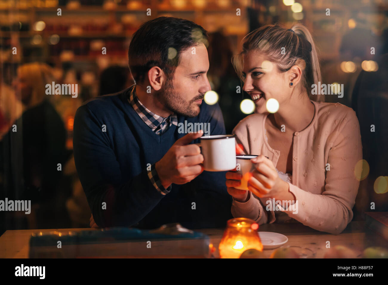 Romantic couple dating at valentines night in pub - Stock Image