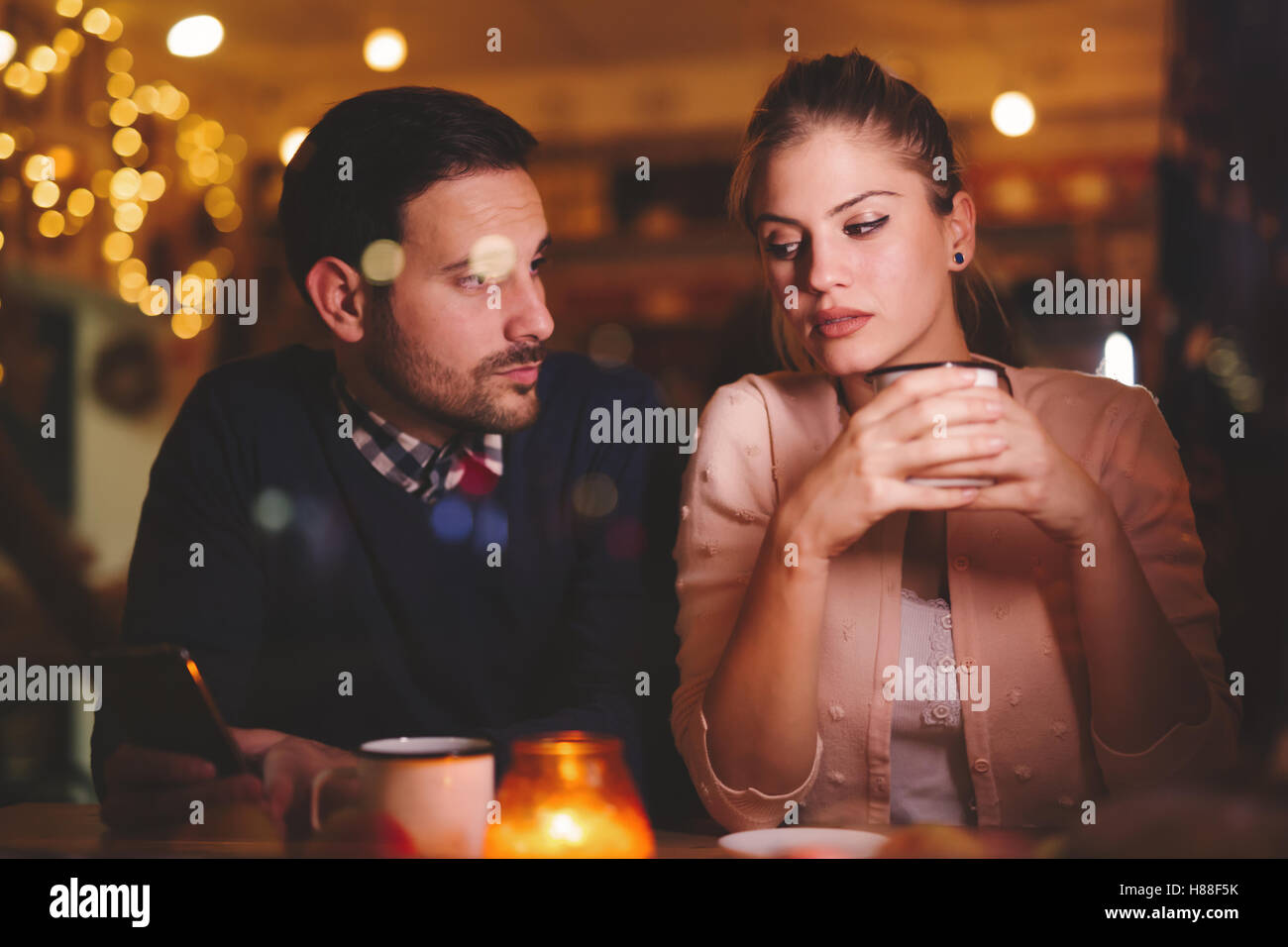 Sad couple having a conflict and relationship problems - Stock Image