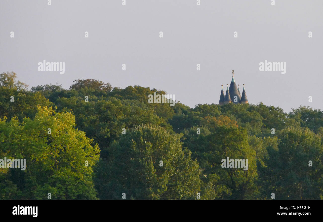 Castle rooftop in the forest during the sunset - Stock Image