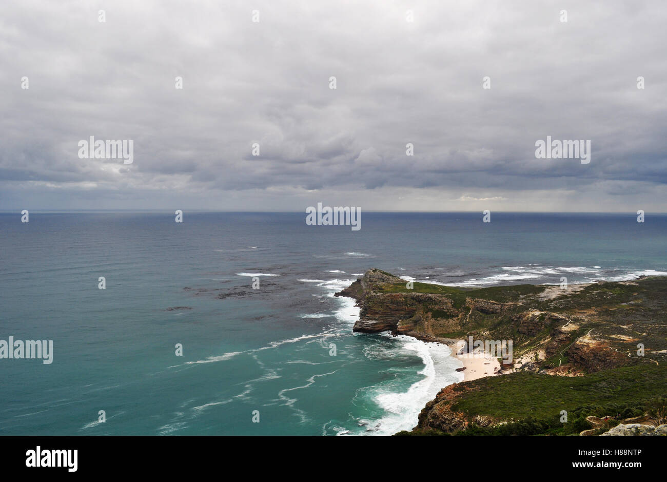 South Africa: waves at the beach of the famous Cape of Good Hope, rocky headland on the Atlantic coast of Cape Peninsula - Stock Image