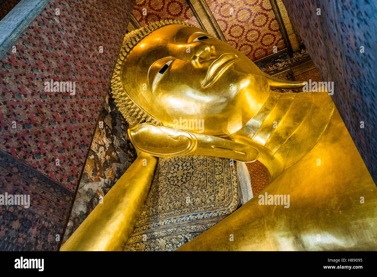 Giant reclining Buddha at Wat Pho in Bangkok. This is one of the most famous Buddha images in Thailand - Stock Image
