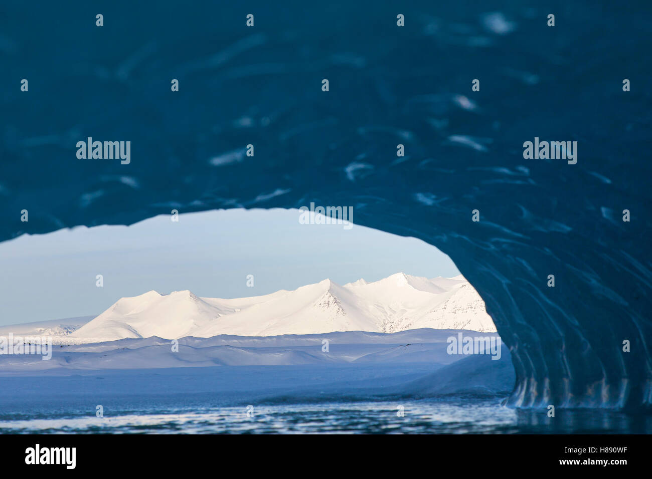 View from ice cave over the Fjallsárlón Glacier Lagoon, glacial lake in winter, Iceland - Stock Image