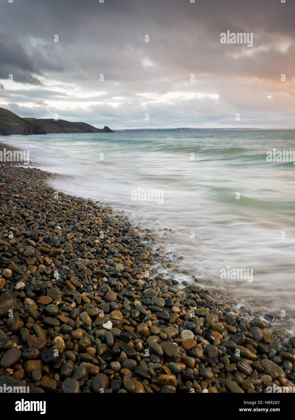 Newgale beach and waves across the pebbles, Pembrokeshire Coast National Park, Wales, UK - Stock Image