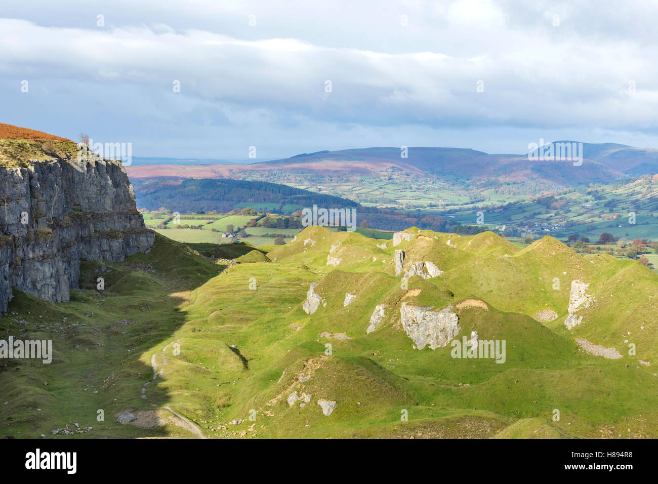 Llangatwg disused quarries and the distant Cafn Moel mountain near Llangattock, Brecon Beacons National Park, Wales, - Stock Image
