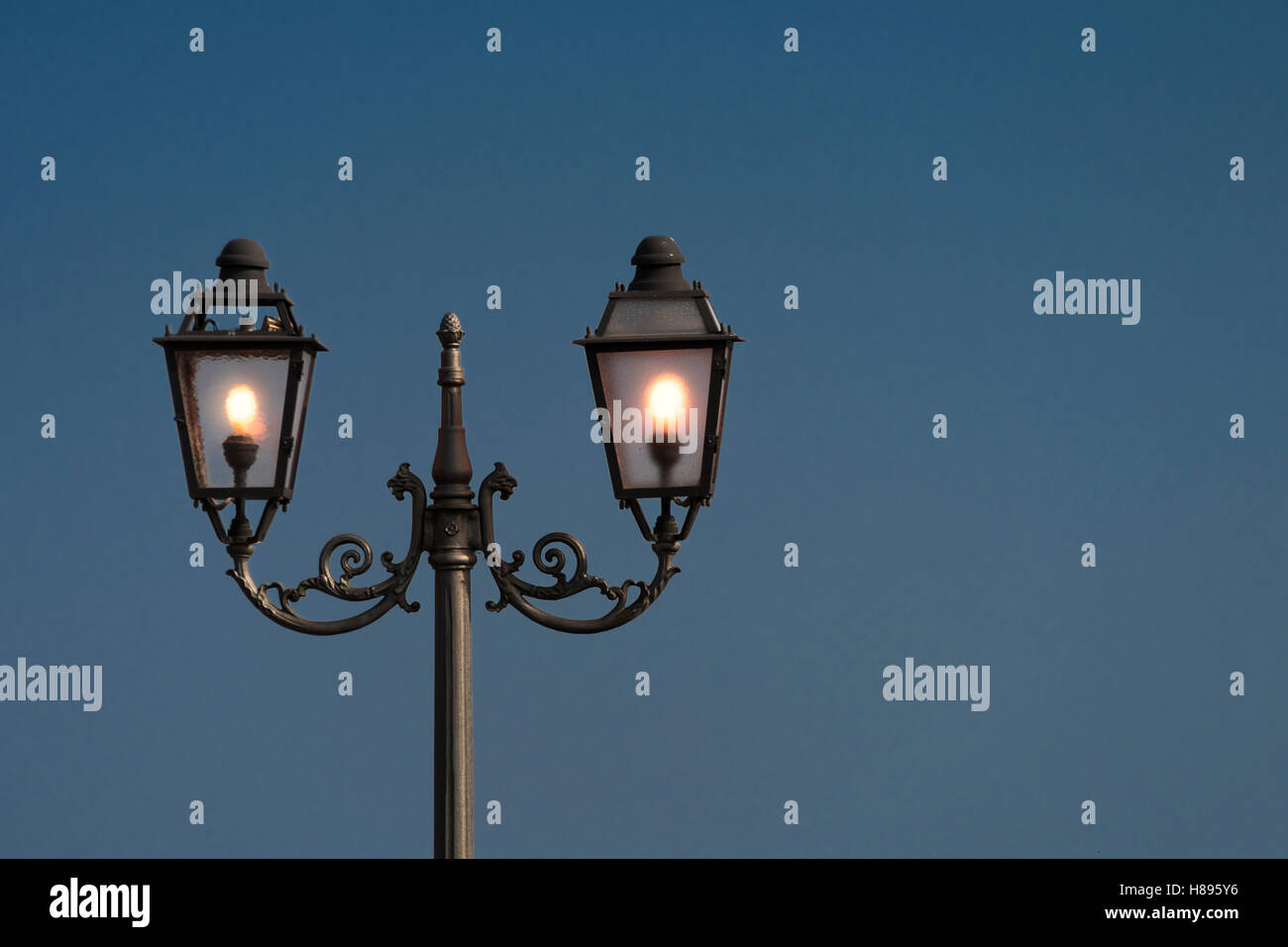 Vintage, old street lamp in classic style, made of cast iron and or metal Stock Photo