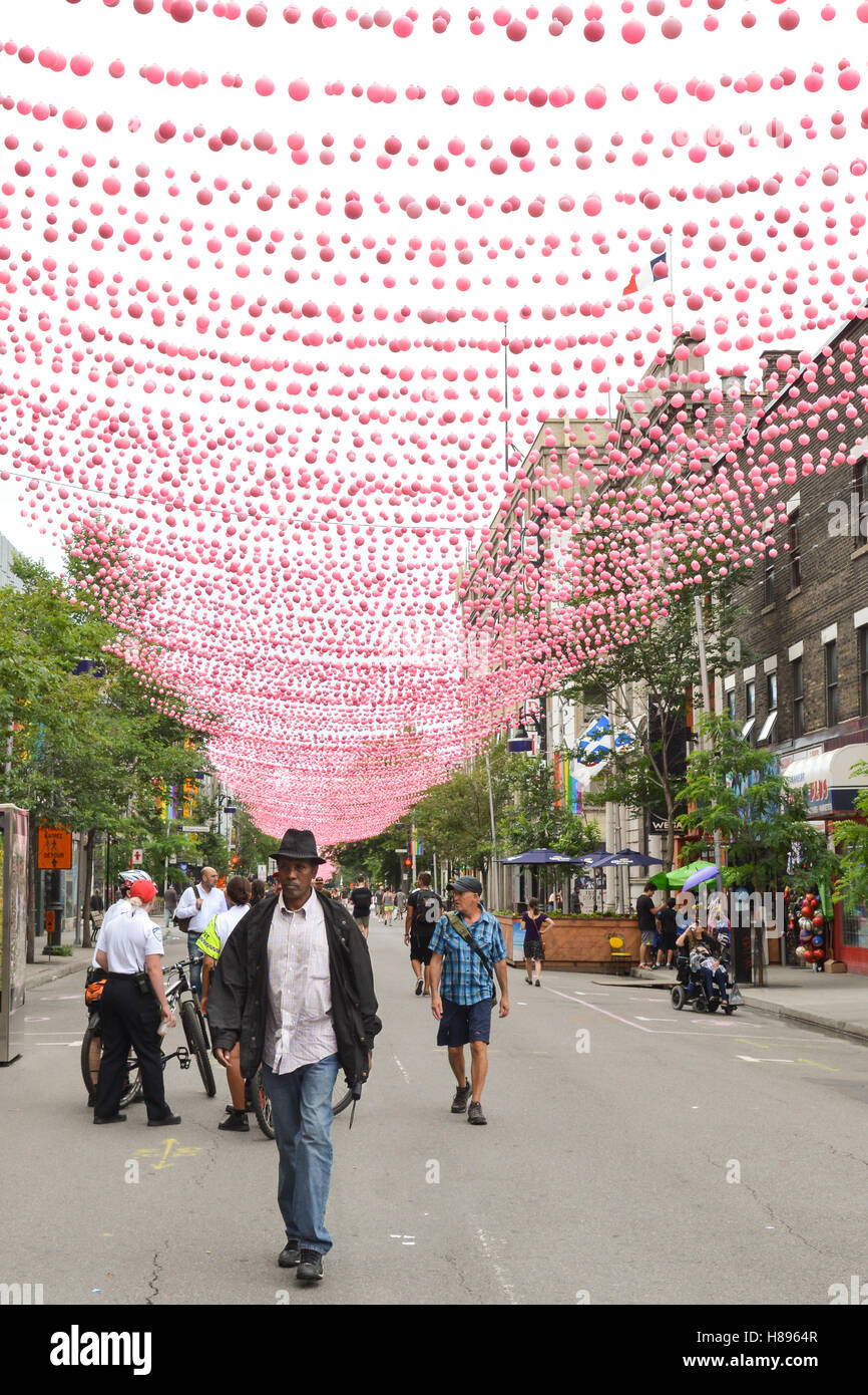 Montreal gay village - Sainte-Catherine Street 'pink balls' (Le Projet de Boules Roses), Montreal, Canada - Stock Image