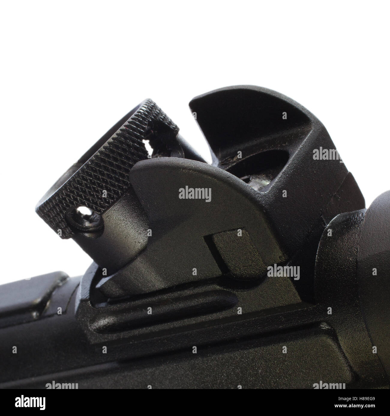 Rear sight on an assault rifle that rotates to different apertures - Stock Image