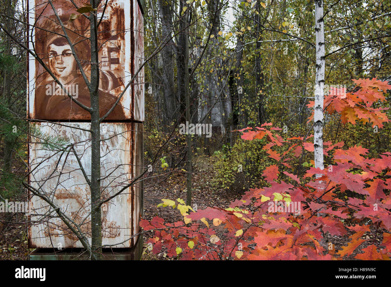 A leftover advertising pillar from the Soviets amid the abandoned, overgrown city of Pripyat. Chernobyl Exclusion - Stock Image