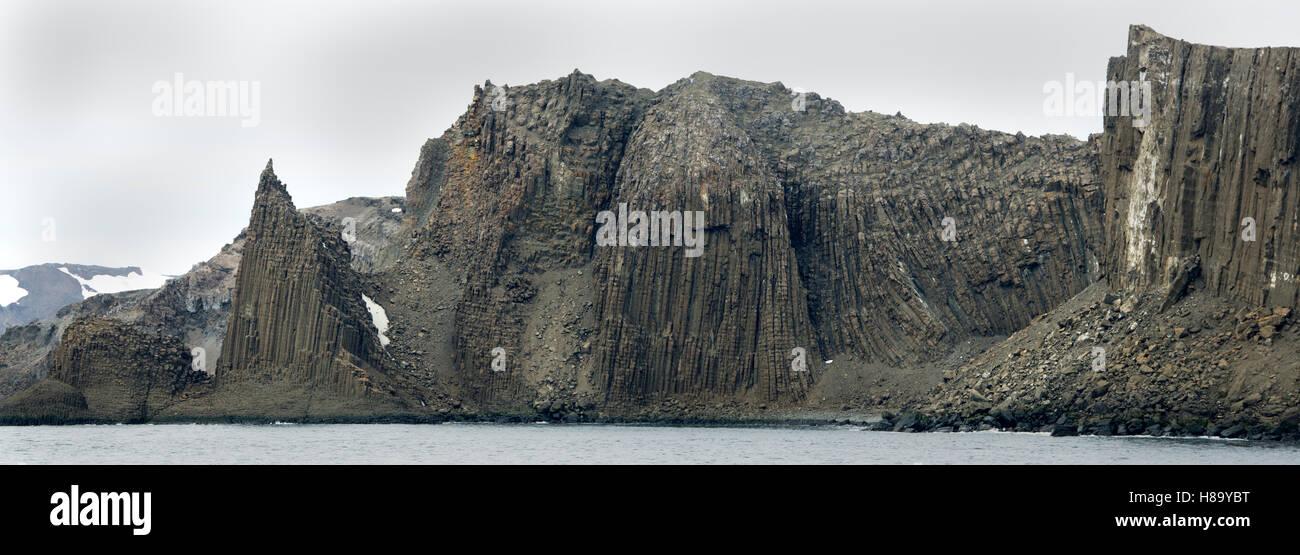 Columnar Basalt, Neptune's Cathedral, Coppermine Peninsula, Robert Island,  English Strait, Antarctica panoramic - Stock Image