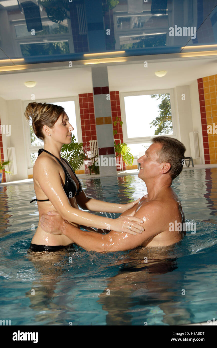 Woman and man in a pool, spa - Stock Image