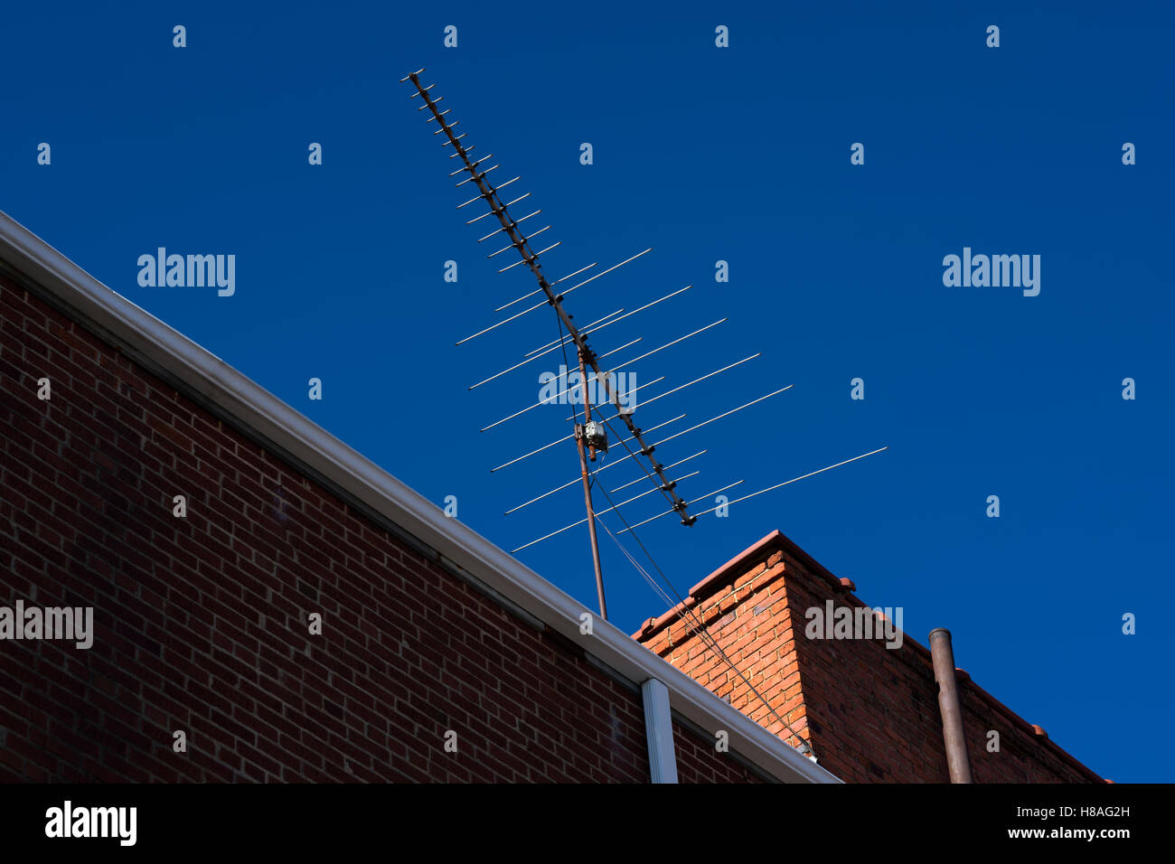 old non HD analog Television antenna on rooftop - Stock Image