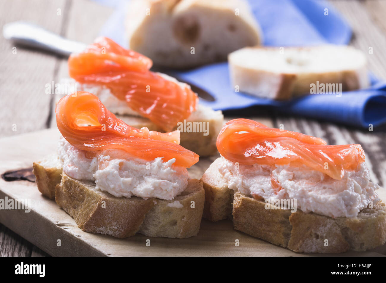 Open sandwich with smoked salmon. Best holiday appetizers - Stock Image