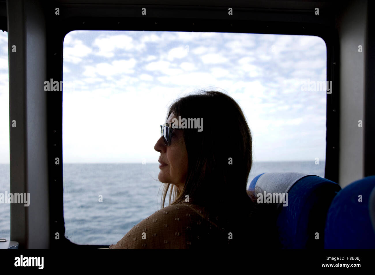 Woman on boat from Long Beach to Catalina Island - Stock Image
