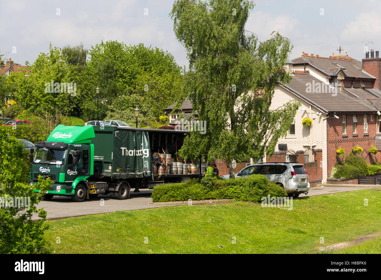 Carlsberg branded lorry making a delivery of beer to The Moorings pub on Boothstown marina on the Bridgewater canal. - Stock Image