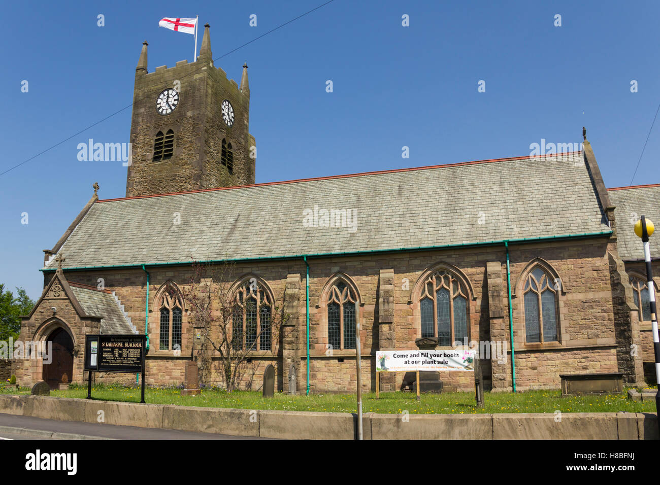 St. Katharine's church, Blackrod near Bolton, Lancashire with a banner advertising the forthcoming plant sale. - Stock Image