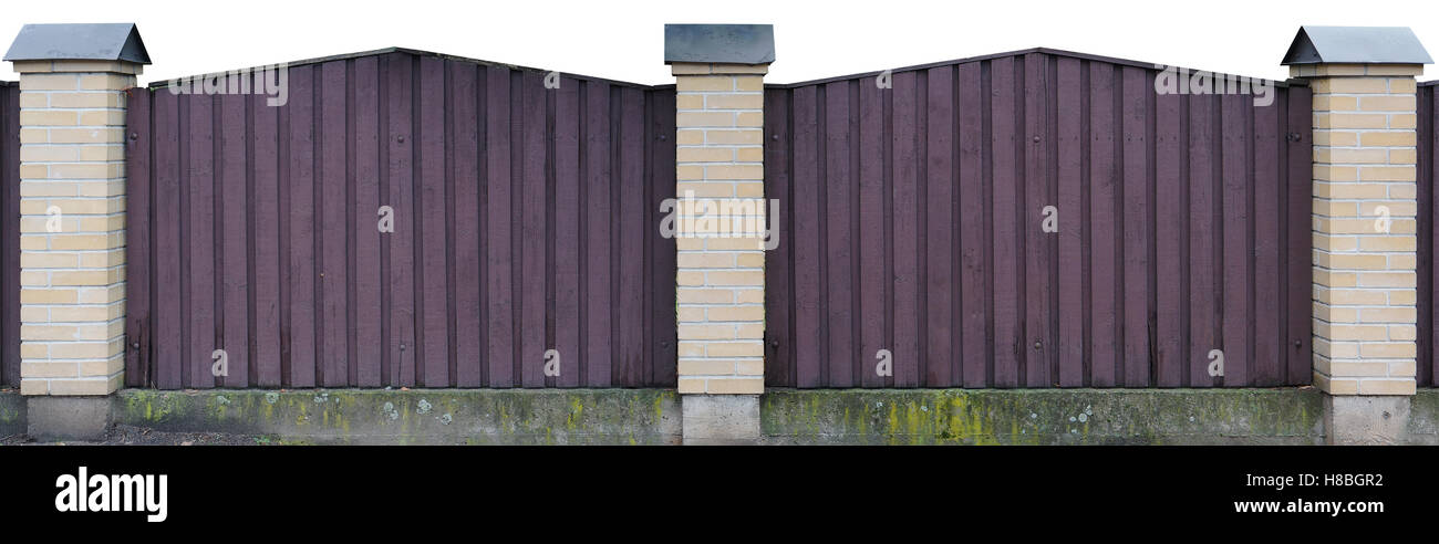 Solid wooden fence from vertical boards of dark lilac color. Isolated with patch panoramic collage - Stock Image
