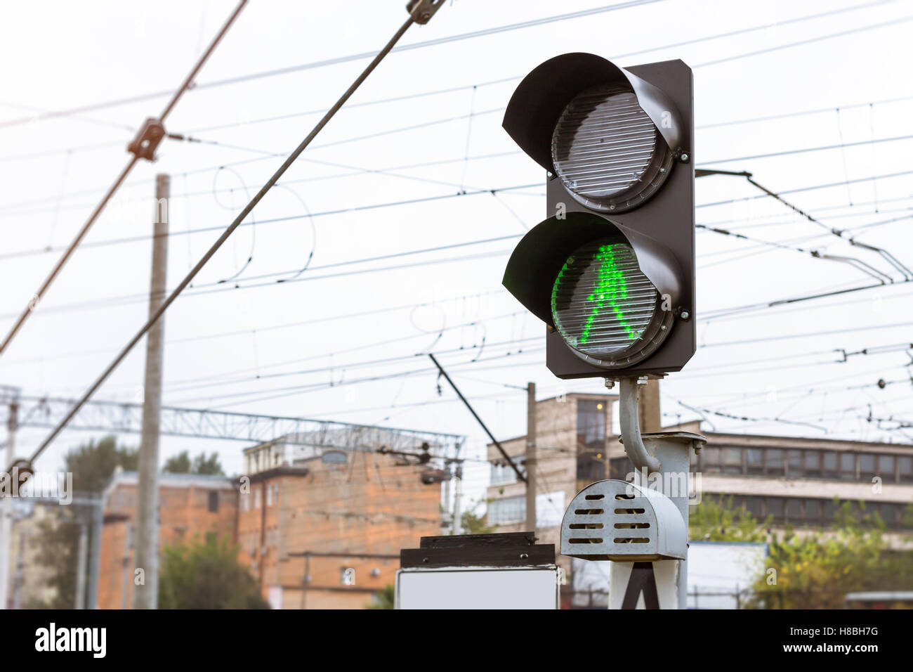 Railway semaphore shines permissive green light. Technical railway station depot. Transport infrastructure on Russia - Stock Image