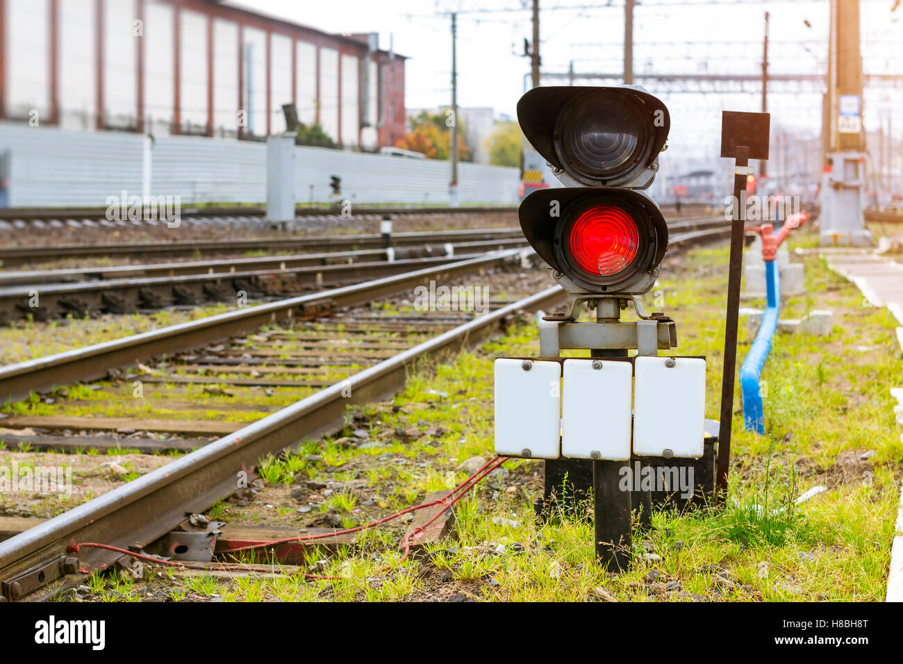 Railway semaphore prohibiting shines red. Technical railway depot. Transport infrastructure of Russian Railways, - Stock Image