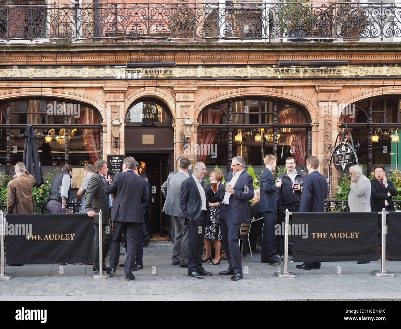 Happy crowd outside a London pub - Stock Image