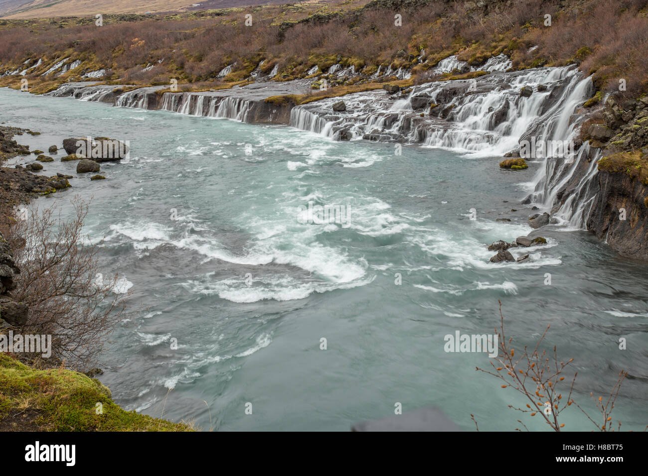 Hraunfossar is waterfall of waterfalls in near Borgarnes town Iceland - Stock Image