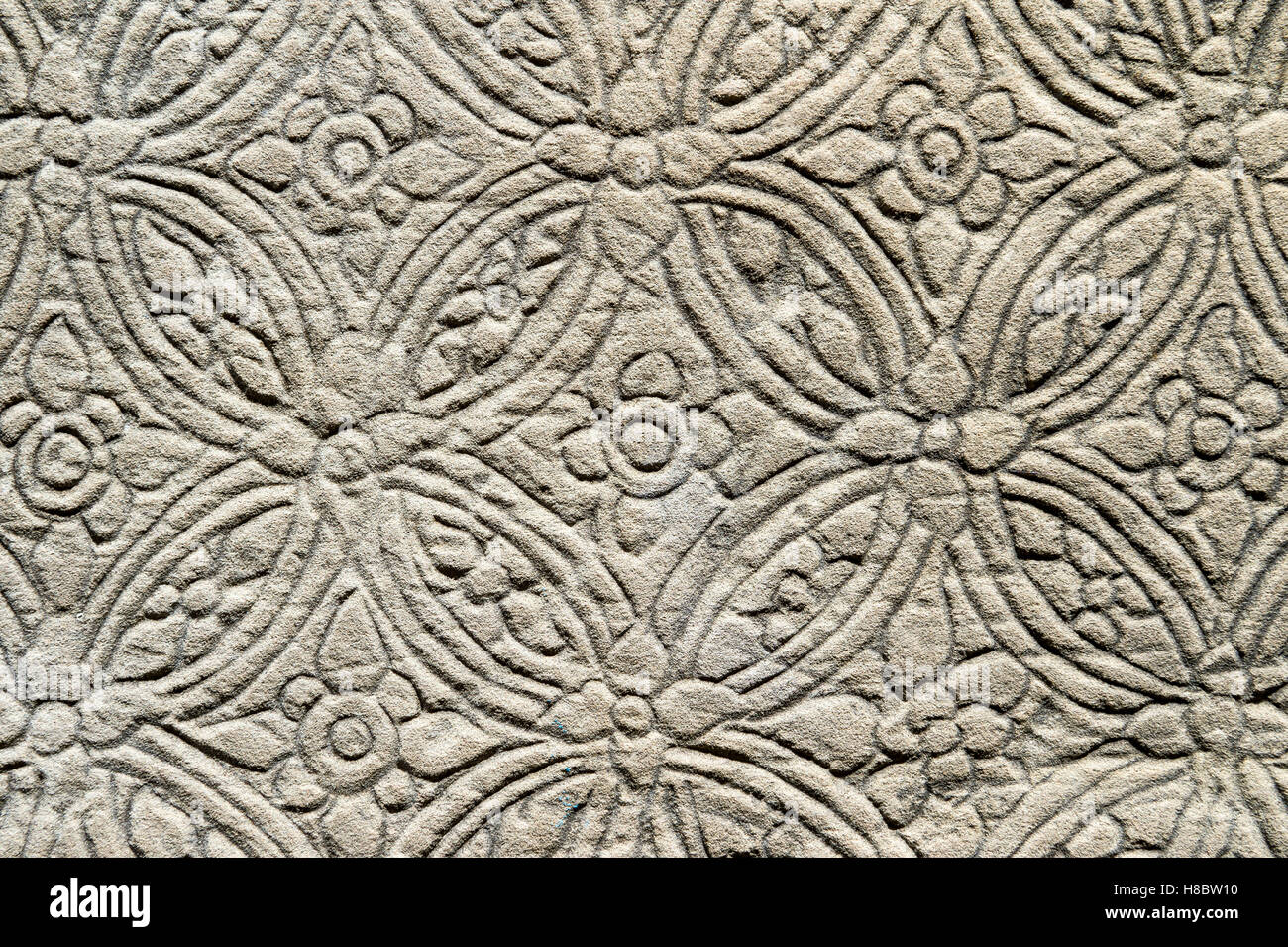 Detail close up of the textured pattern of a carving in relief on