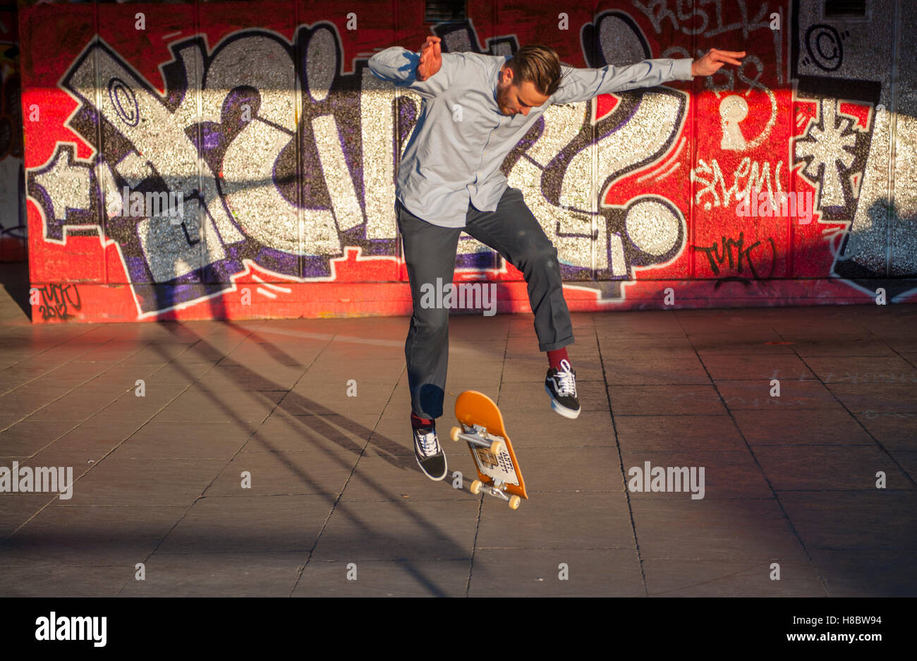 Skateboarder at the skate board park under the national theater, on London's southbank - Stock Image