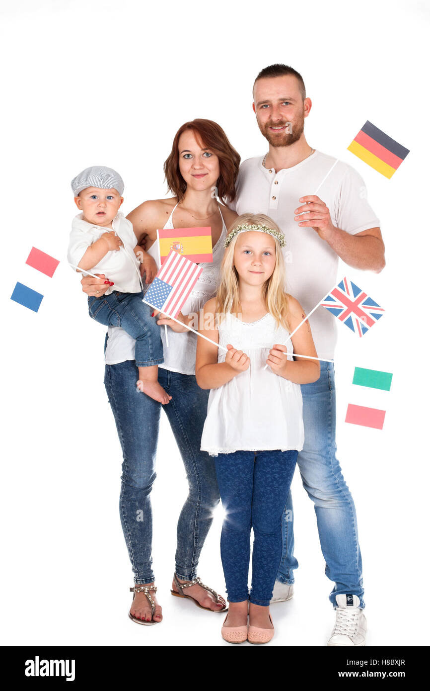 group of people- family holding a flag and looking at the camera. International education concept - Stock Image