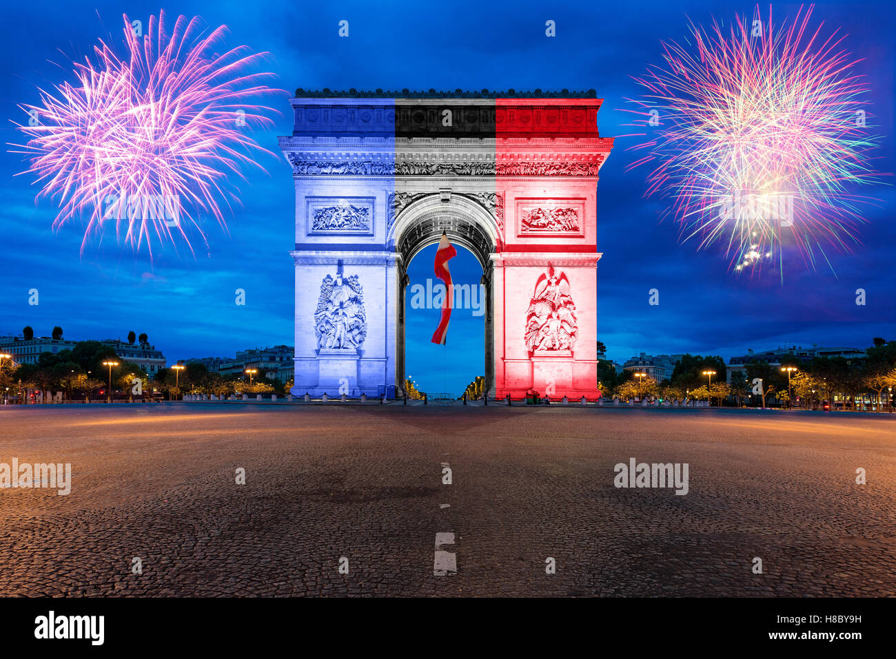 Arc de Triomphe Paris and Champs Elysees with New year fireworks at Paris, France. - Stock Image