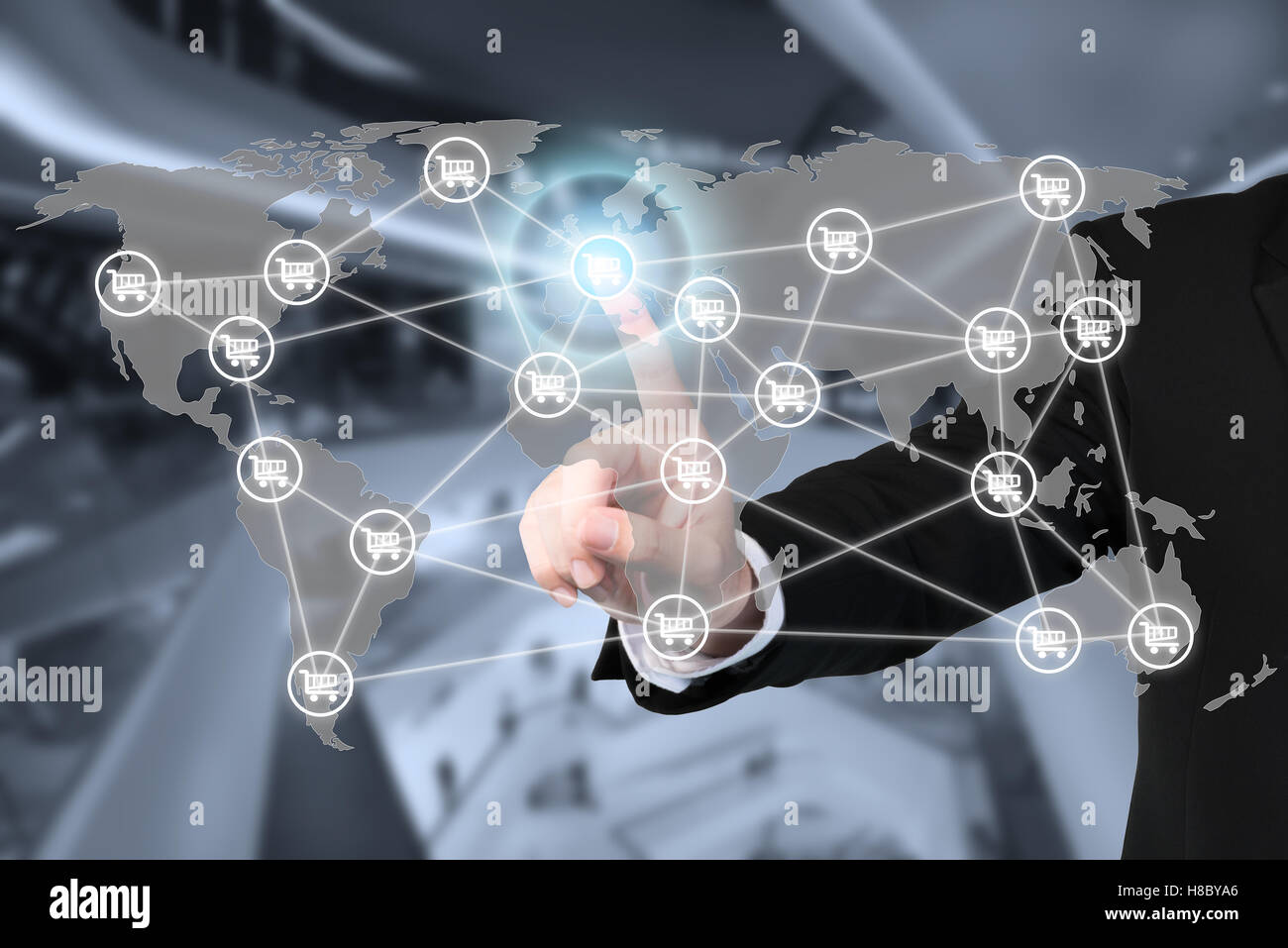 E-commerce business and global network connection and cart sign with shopping mall in background. E-commerce business - Stock Image