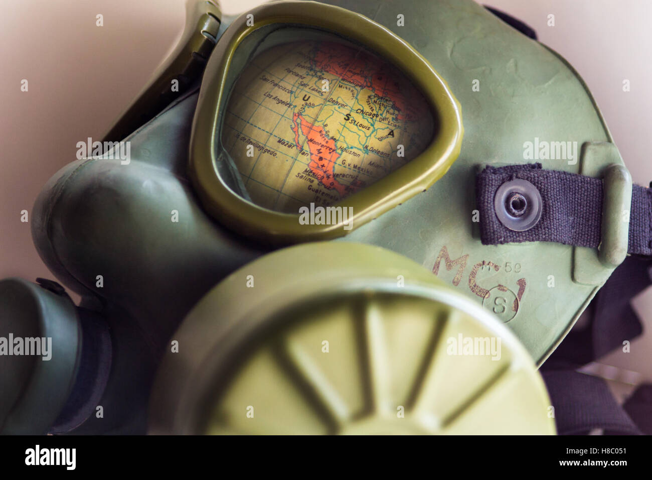 BELGRADE, SERBIA - NOVEMBER 10, 2016: Part of World map with USA shows through a WWII army gas mask (manufacturer - Stock Image