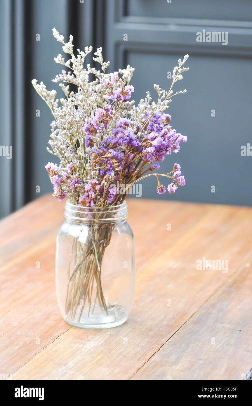 statice flowers in a vase ,blur background - Stock Image