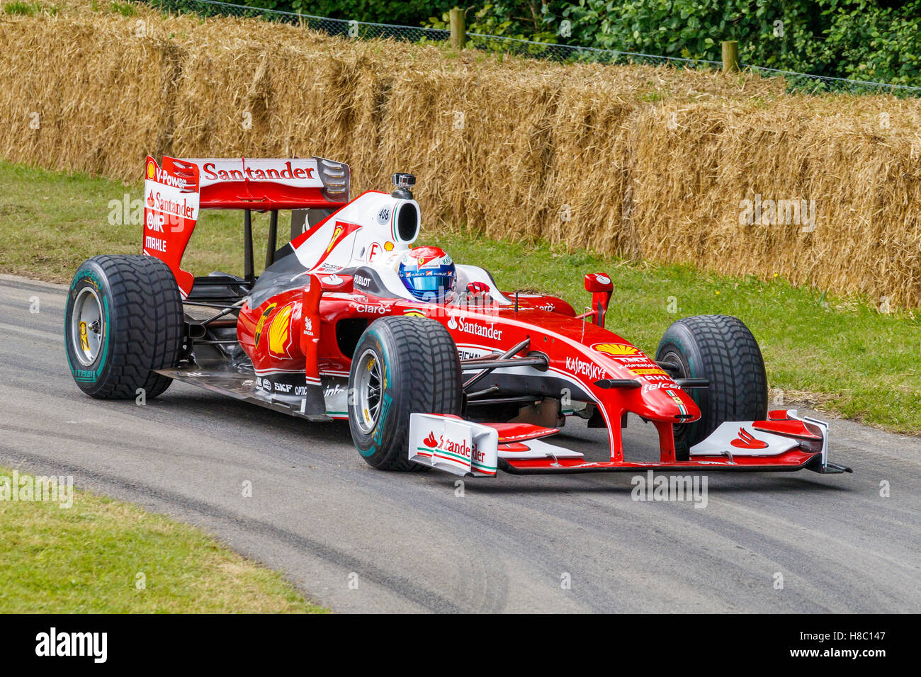 2010 Ferrari F10 with driver Marc Gené at the 2016 Goodwood Festival ...