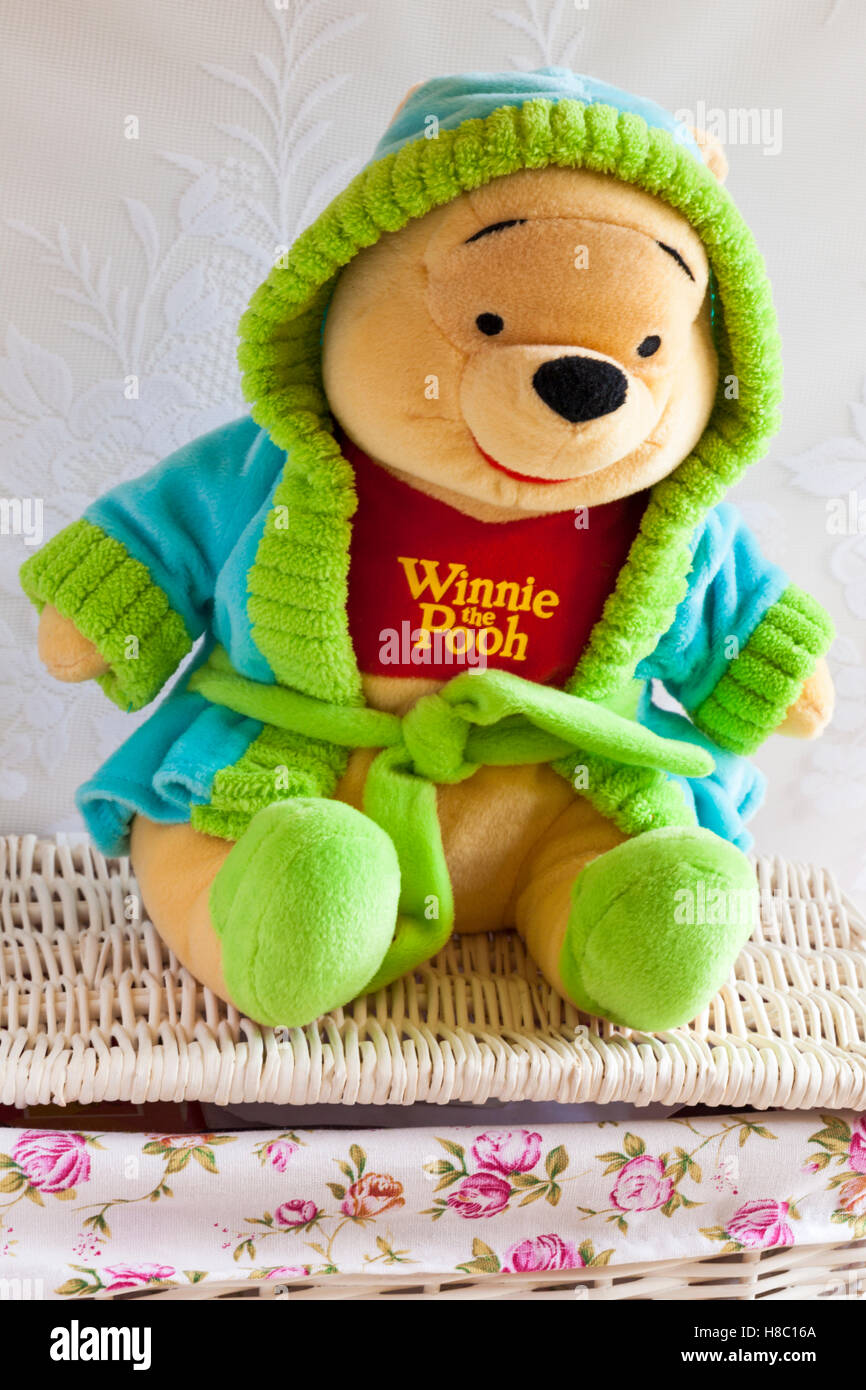 Winnie the Pooh bear soft cuddly toy wearing dressing gown with hood up  sitting on wicker basket 2b85c6d7c34b