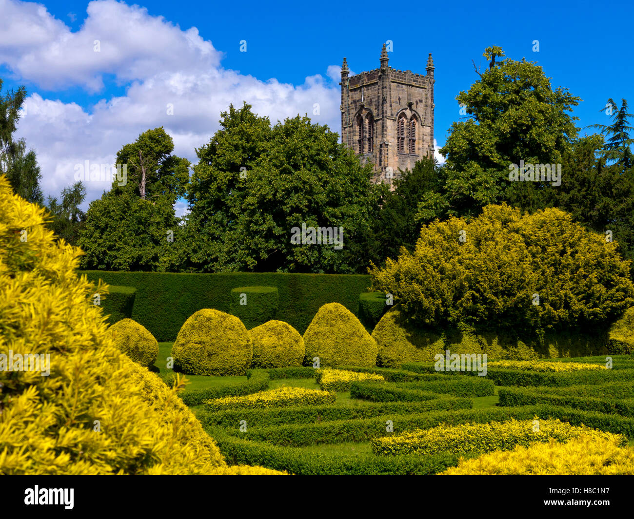 Church in the grounds of Elvaston Country Park near Derby Derbyshire England UK with Italian Garden in foreground - Stock Image
