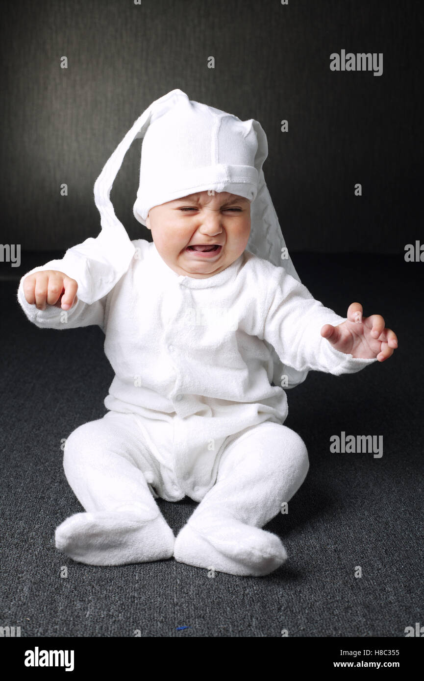 unhappy boy with panty on head Stock Photo