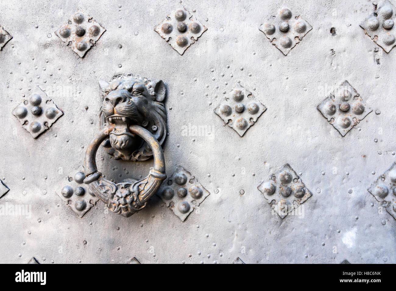 Detail of a lion head door knocker at Castell de Riudabella, Vimbodí, Tarragona, Spain - Stock Image