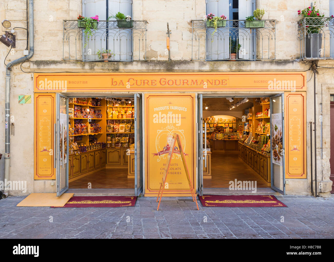 La Cure Gourmande shop facade in the town of Uzès, Gard, France - Stock Image
