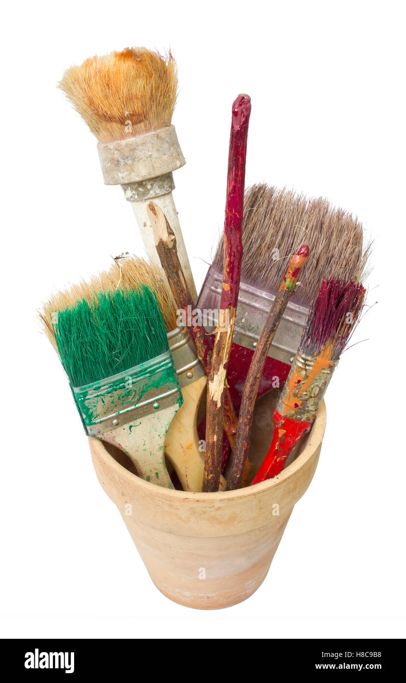 Tools of the rural painter - dirty brushes and sticks for stirring of paints. Isolated - Stock Image