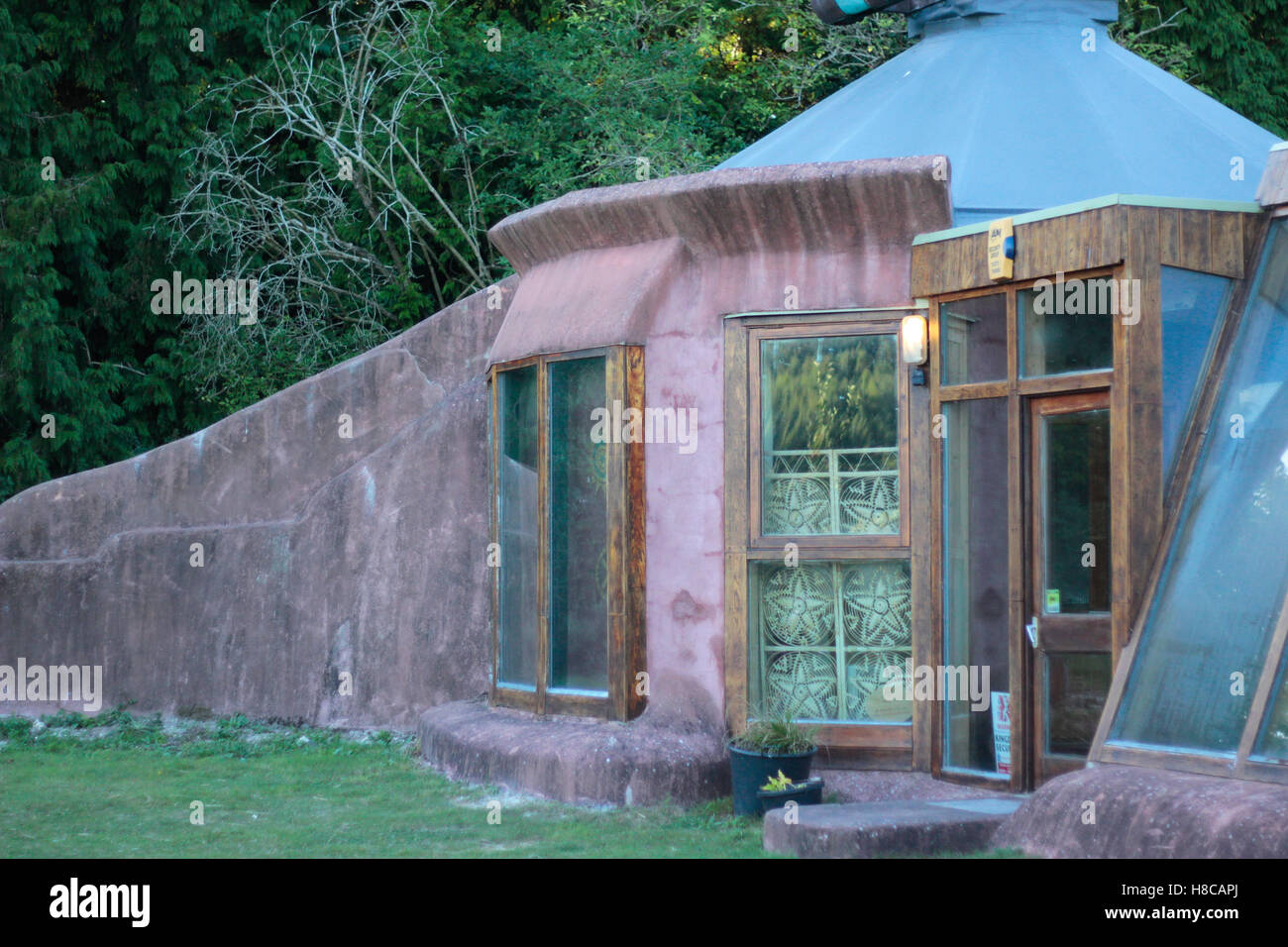 Part of front of self-sufficient Earthship building at Stanmer Park, Brighton based on design by Mike Reynolds - Stock Image