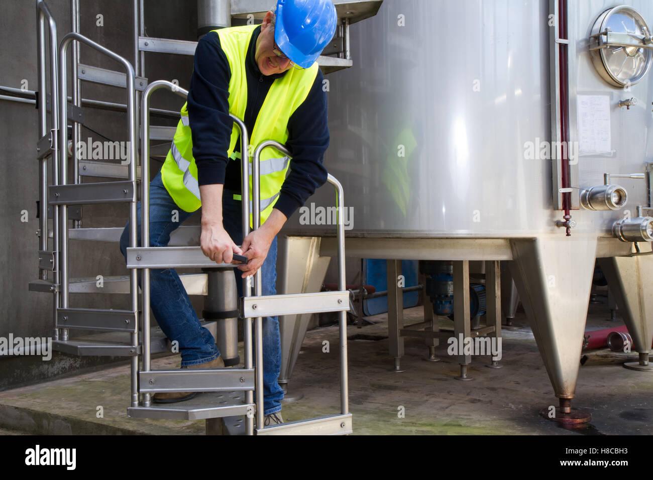 skilled worker making maintenance in industrila premises - Stock Image