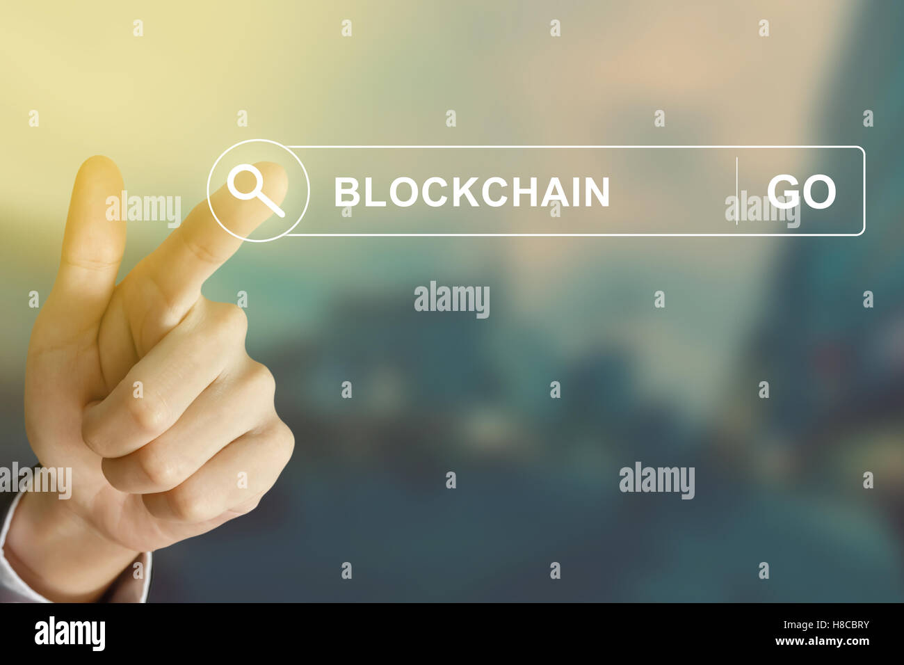 business hand clicking blockchain button on search toolbar with vintage style effect - Stock Image