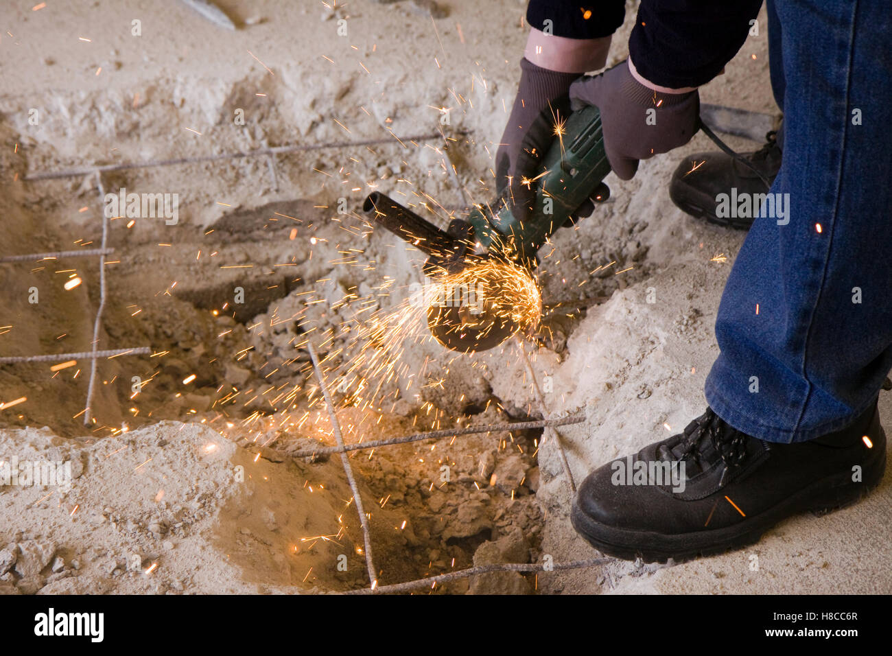 bricklayer at work in a building site - Stock Image