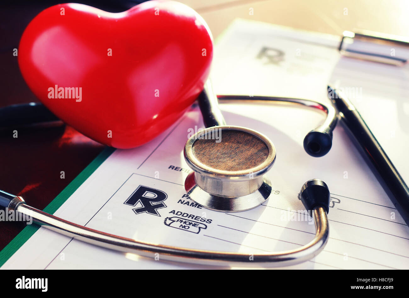 cardiologist stethoscope paper insurance - Stock Image