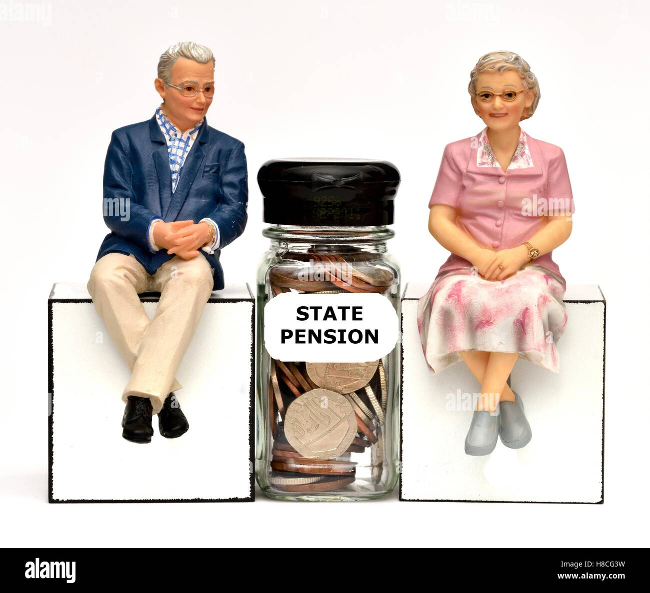 Two pensioner figurines with a state pension jar. - Stock Image