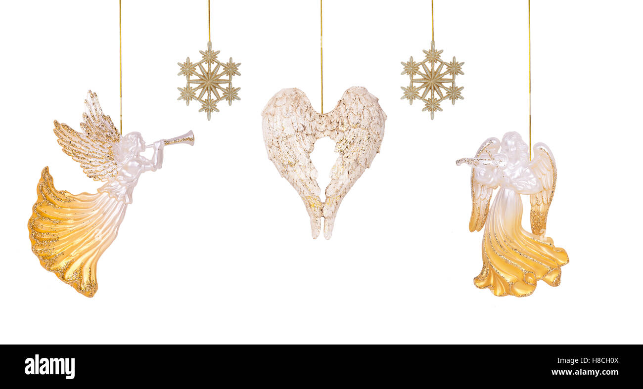 Christmas angels, snowflakes, and the wings are suspended on golden ...