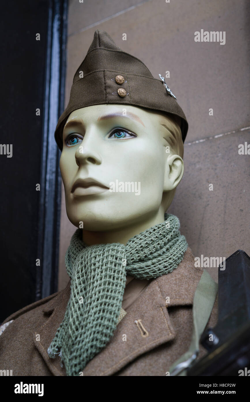 Coldstream, Berwickshire, Scotland on the English border - military uniform in a militaria shop. - Stock Image
